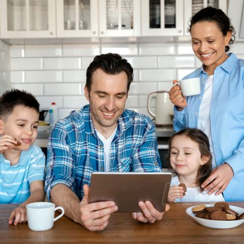 medium shot parents kids with tablet
